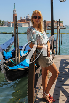Pretty woman with long blond hair in Venice, Italy