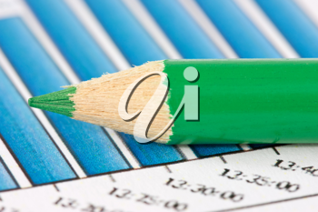 Royalty Free Photo of a Pencil on Financial Graphs