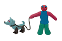 Royalty Free Photo of a Plasticine Man Walking a Dog