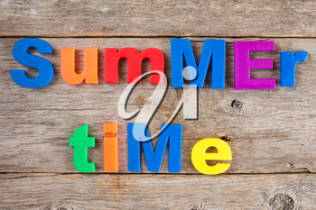 Letter magnets spelling text Summer time