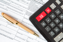 Calculator and form 1042-s which confirms the payment of the tax in the USA