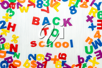 Sentence Back to school in colorful plastic letters