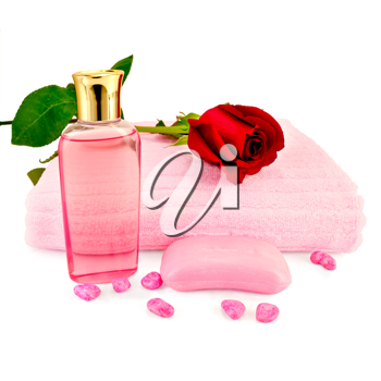 Bottle of pink shower gel, pink soap, towels, bath salt and red roses isolated on white background