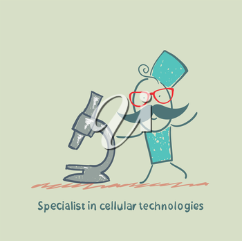 Specialist in cellular technologies looks looks through a microscope
