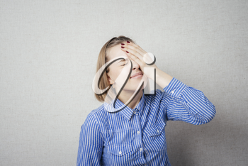 upset young woman with hand on his head