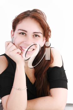 Portrait of a pretty young businesswoman at the office desk holding a pen against white background