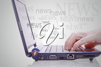 Image of hand on the laptop keyboard with the word news out of the screen.