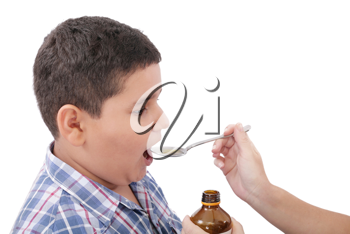 Child taking cough medicine because of the flu