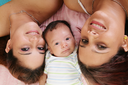 Royalty Free Photo of Two Women With a Baby