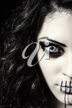 Royalty Free Photo of a Scary Girl With Her Mouth Sewn Shut