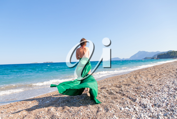 Royalty Free Photo of a Woman By the Ocean