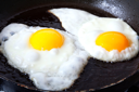 Royalty Free Photo of Two Eggs in a Frying Pan