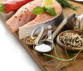 Wild Rice And Salmon With Spices On A Wooden Board