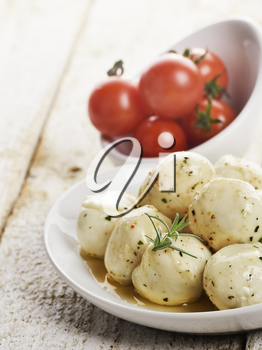Mozzarella Cheese And Cherry Tomatoes In White Bowls