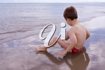 A Young child alone on the beach