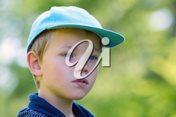 A young child with a cap