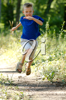 A Young boy running in nature