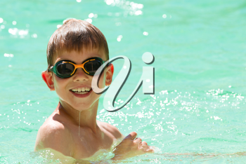 Young child swimming in the pool