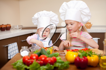 Royalty Free Photo of Two Little Girls Preparing Food