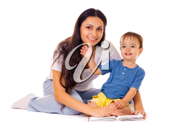Royalty Free Photo of a Mother Reading a Book With Her Son