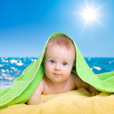 Royalty Free Photo of a Baby at the Beach