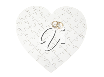 Royalty Free Photo of Rings on a Heart Puzzle