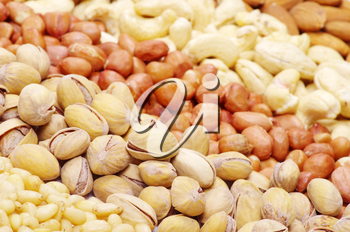 Varieties of nuts: peanuts, hazelnuts, cashews, pistachio