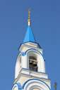 Christian church with dark blue domes of white color against the dark blue sky