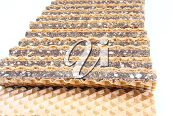 Wafer cookies with chocolate are isolated on a white background