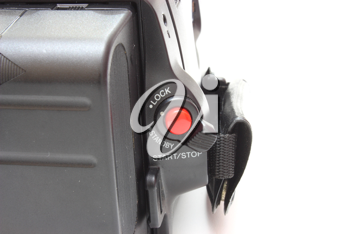 Black videocamera with buttons and switches on a white background
