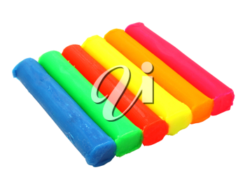 Color children's plasticine lies on a white background