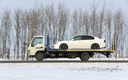The wrecker carries the car of white color