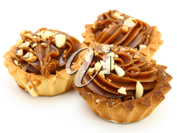Pie a basket with chocolate condensed milk and nuts on a white background