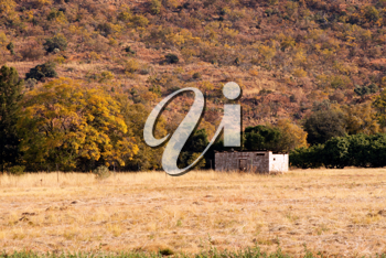 Royalty Free Photo of a Small Abandoned Shack Near the Mountains