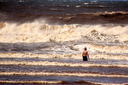 Lone Boy Standing in the Stormy Sea