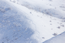 Trail of climbers on the snow in the mountains