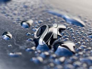 drops of water on a dark car