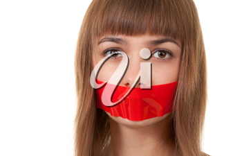 Royalty Free Photo of a Girl With Her Mouth Sealed