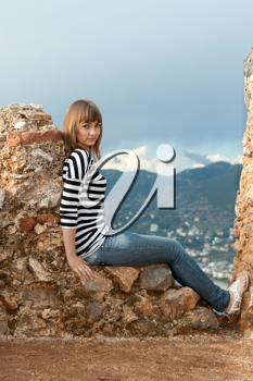 Royalty Free Photo of a Girl on an Old Fortress