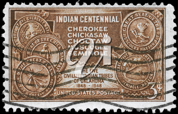 Royalty Free Photo of 1948 US Stamp Shows the Map of Indian Territory and Seals of Five Tribes, Centennial