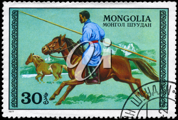 MONGOLIA - CIRCA 1977: A Stamp printed in MONGOLIA shows the image of the Hunter on Horseback, series, circa 1977