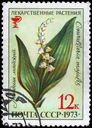 USSR - CIRCA 1973: A Stamp printed in USSR shows the Lily of the Valley, with the description
