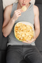 Royalty Free Photo of a Man Eating Potato Chips