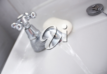 Royalty Free Photo of a Running Faucet