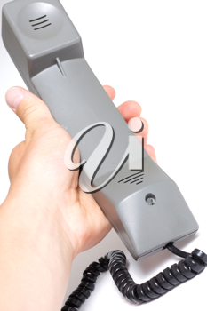 Royalty Free Photo of a Person Holding a Telephone Handle