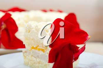 whipped cream mango cake with red rose petals