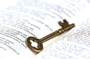 Royalty Free Photo of a Key on a Bible