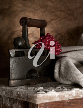 Royalty Free Photo of an Old Iron and Fabric