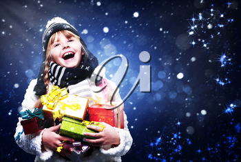 Happy young girl with many Christmas gifts, abstract art backgrounds