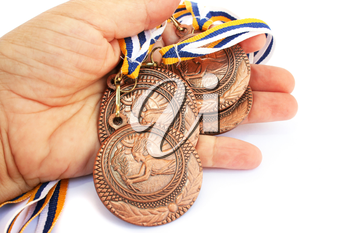 Royalty Free Photo of a Person Holding Medals